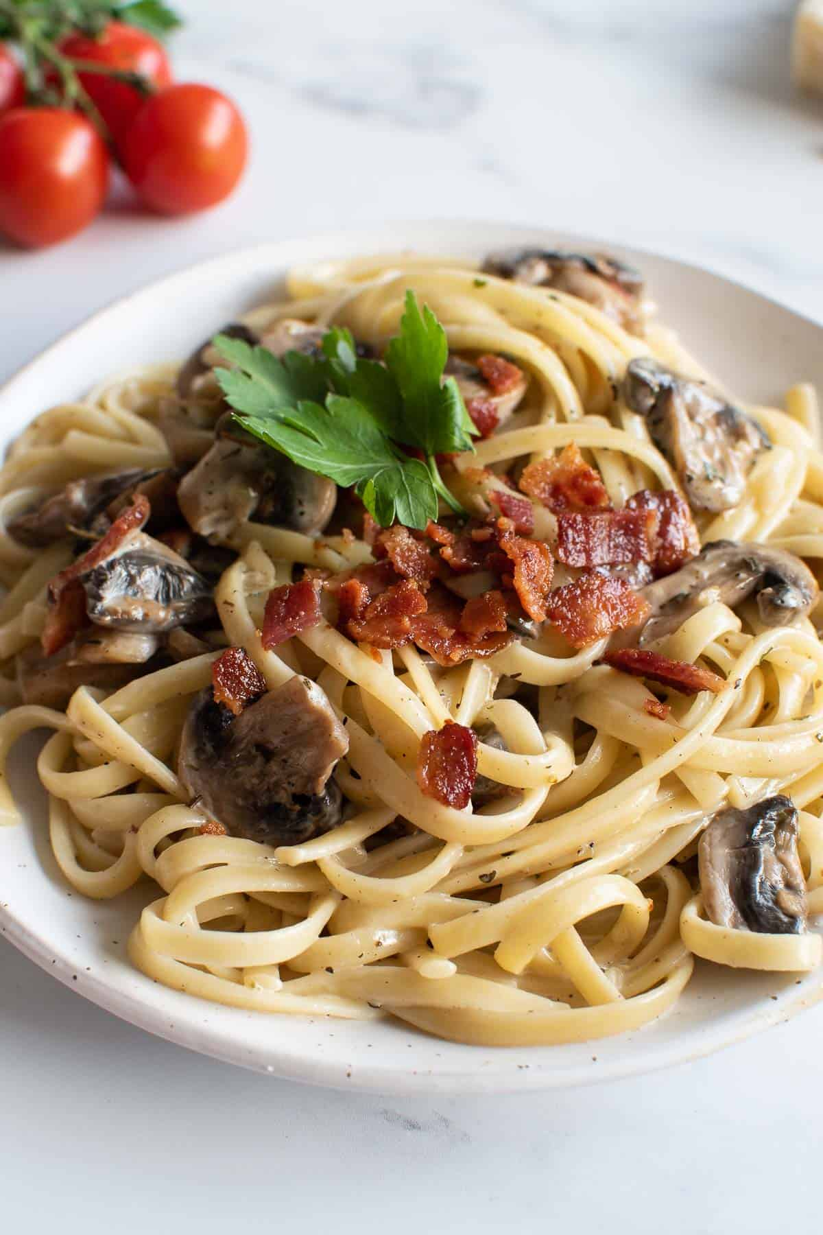 Linguine in a creamy sauce with bacon and mushrooms.