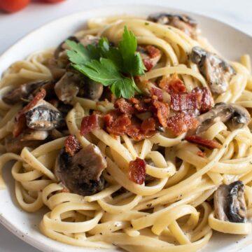 Close up of bacon and mushroom pasta.
