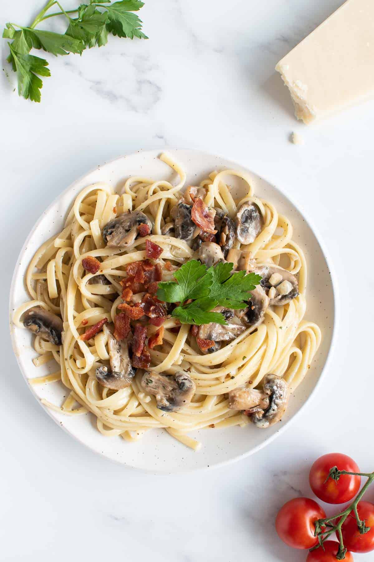 Bacon and mushroom linguine with parmesan on the side.