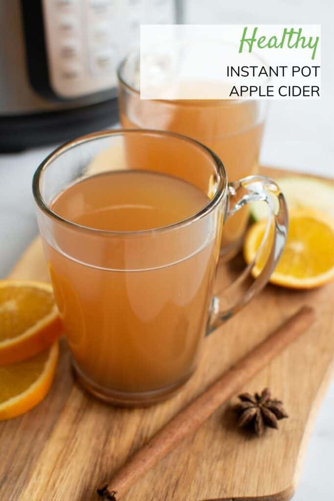 Close up of glass of hot apple cider.