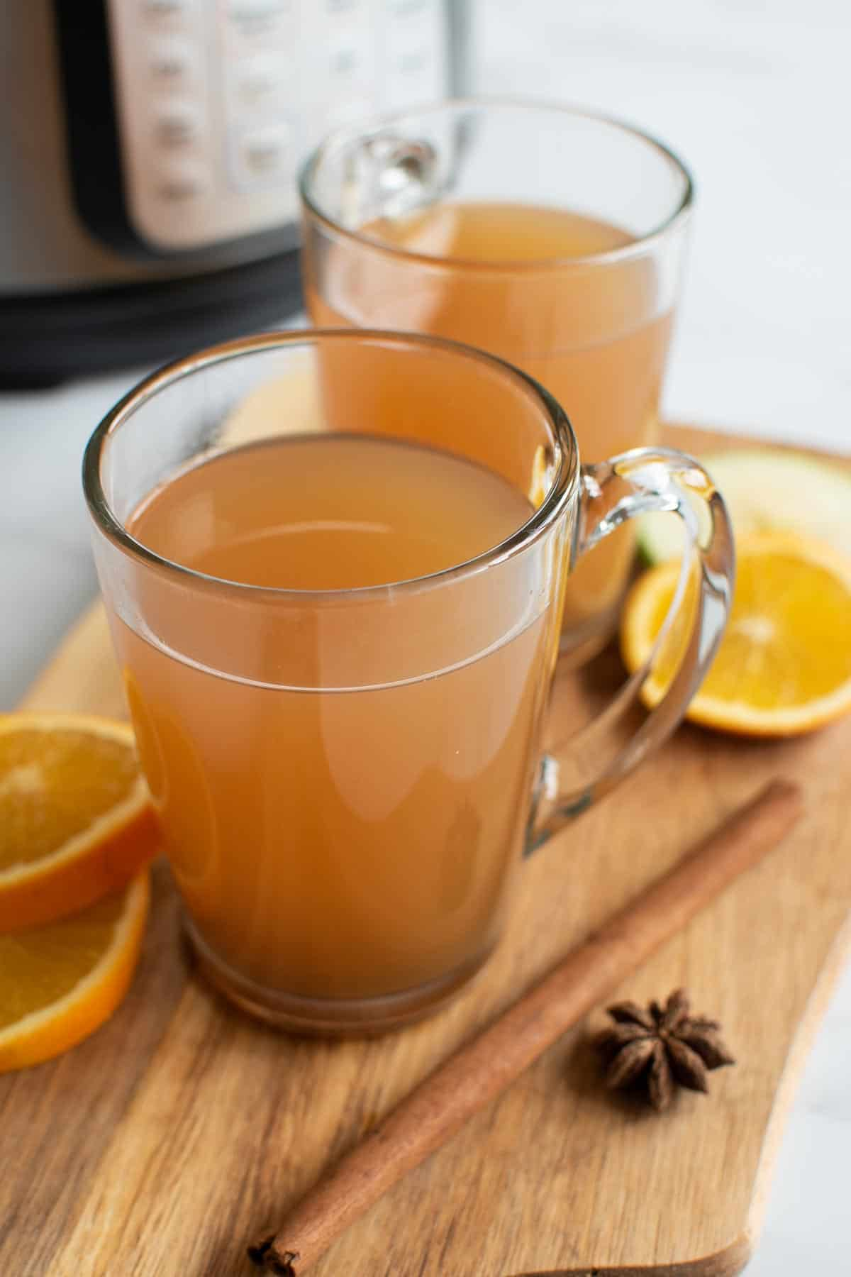 Two glasses of Instant Pot mulled apple cider.