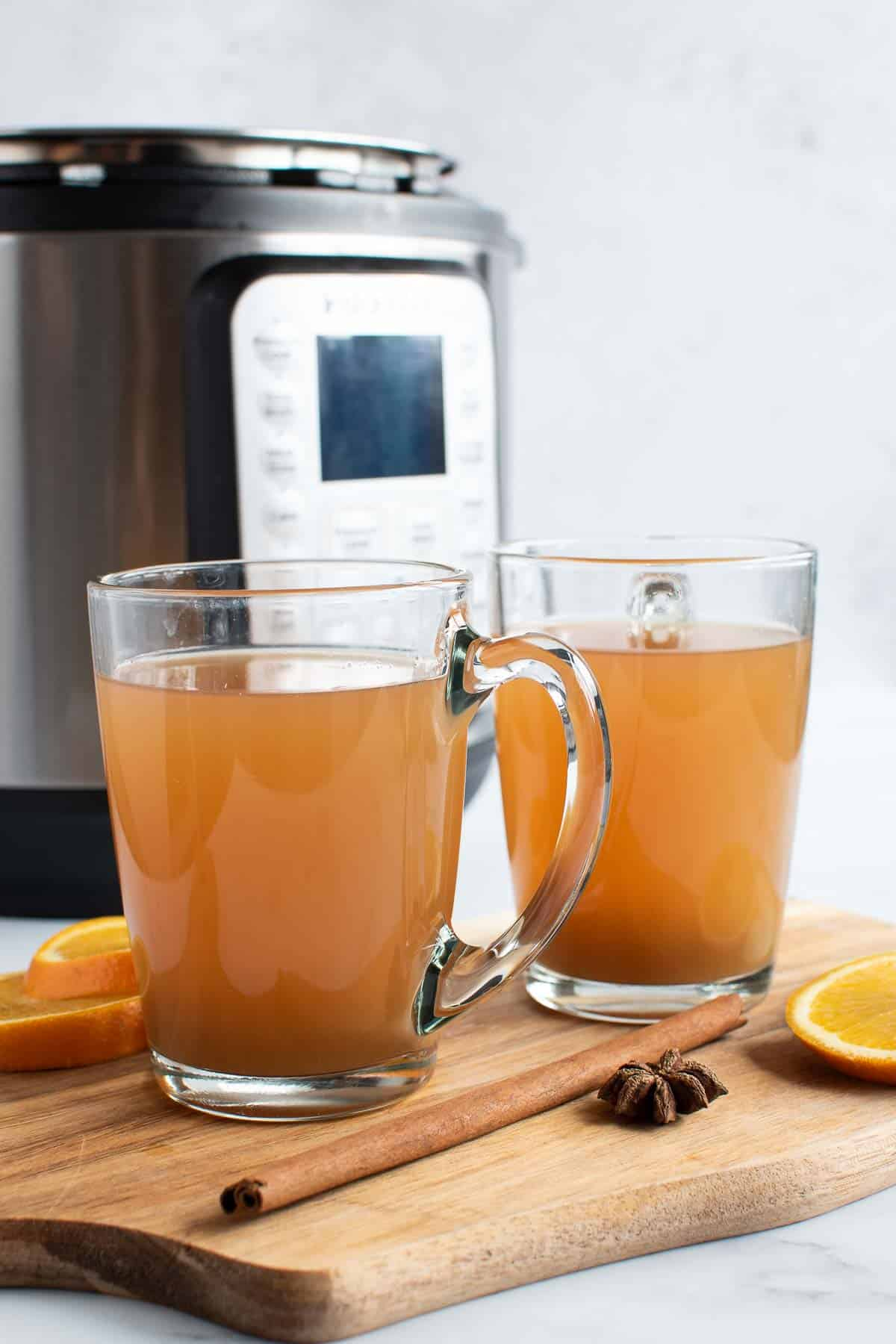 Apple cider in front of an Instant Pot.