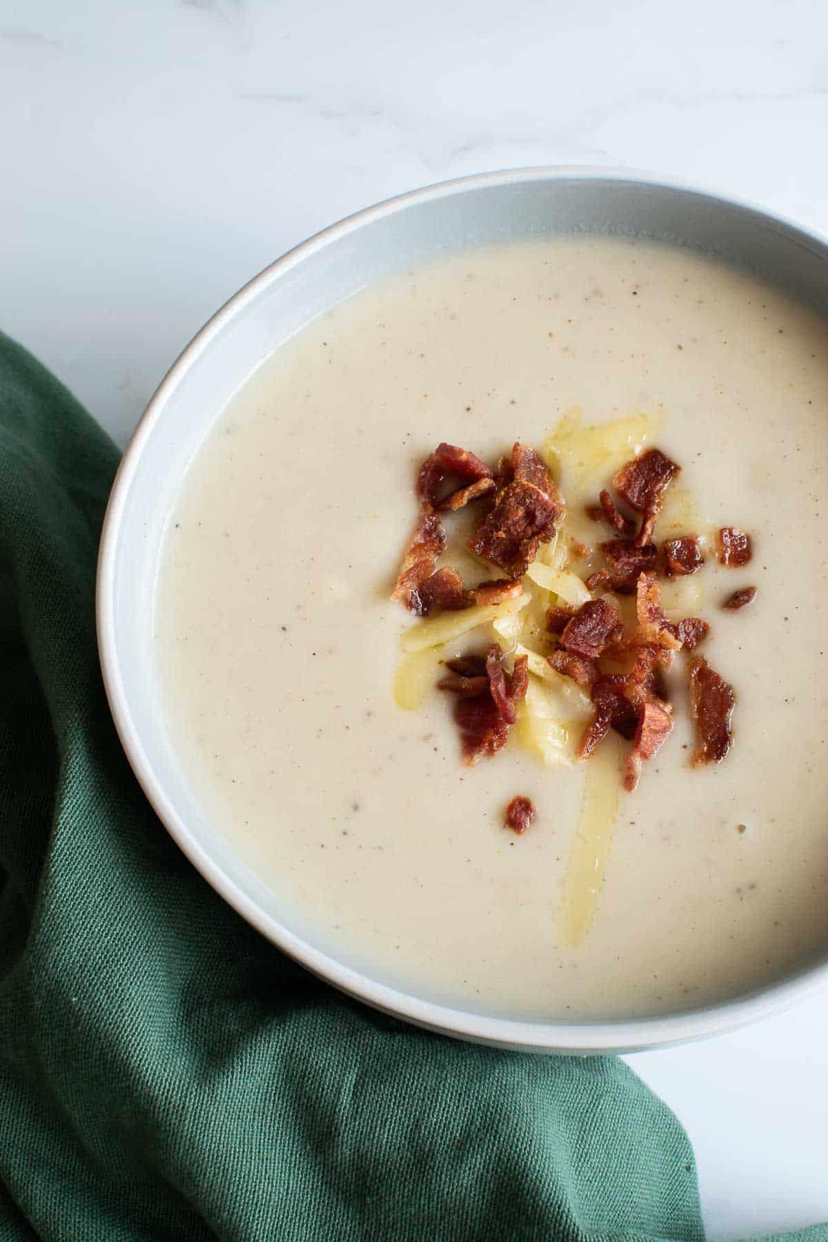 Creamy cauliflower soup with bacon bits.