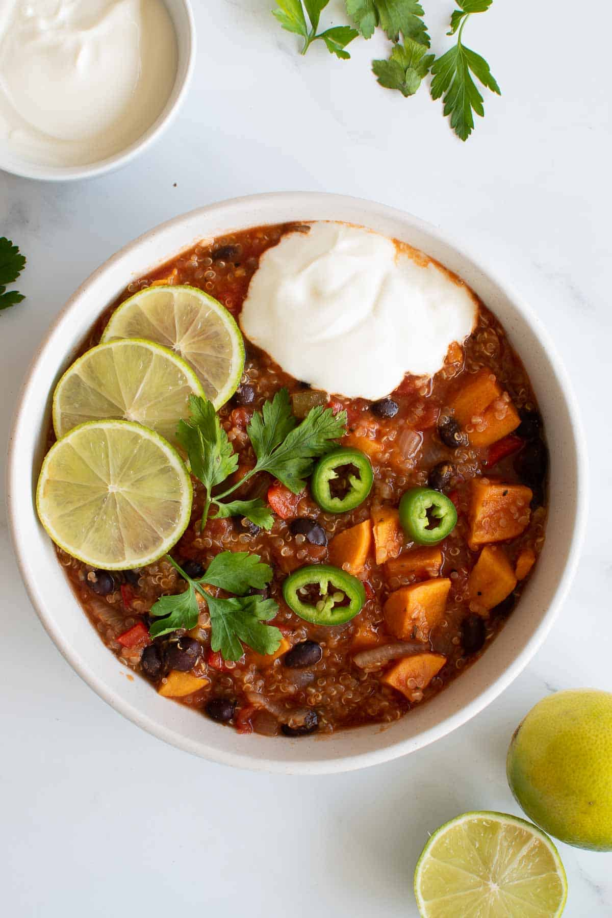 A bowl of sweet potato, quinoa and black bean chili made in a pressure cooker.