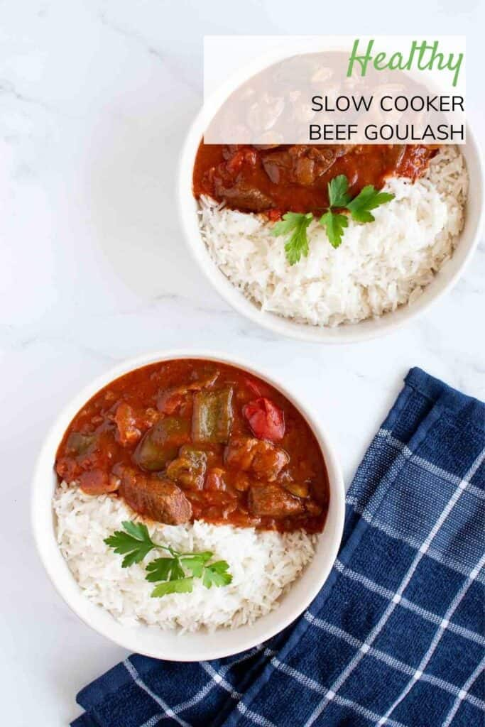Two bowls of slow cooker beef goulash and rice.