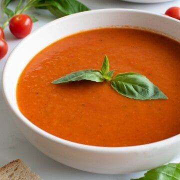Spicy tomato soup with basil and red pepper flakes.